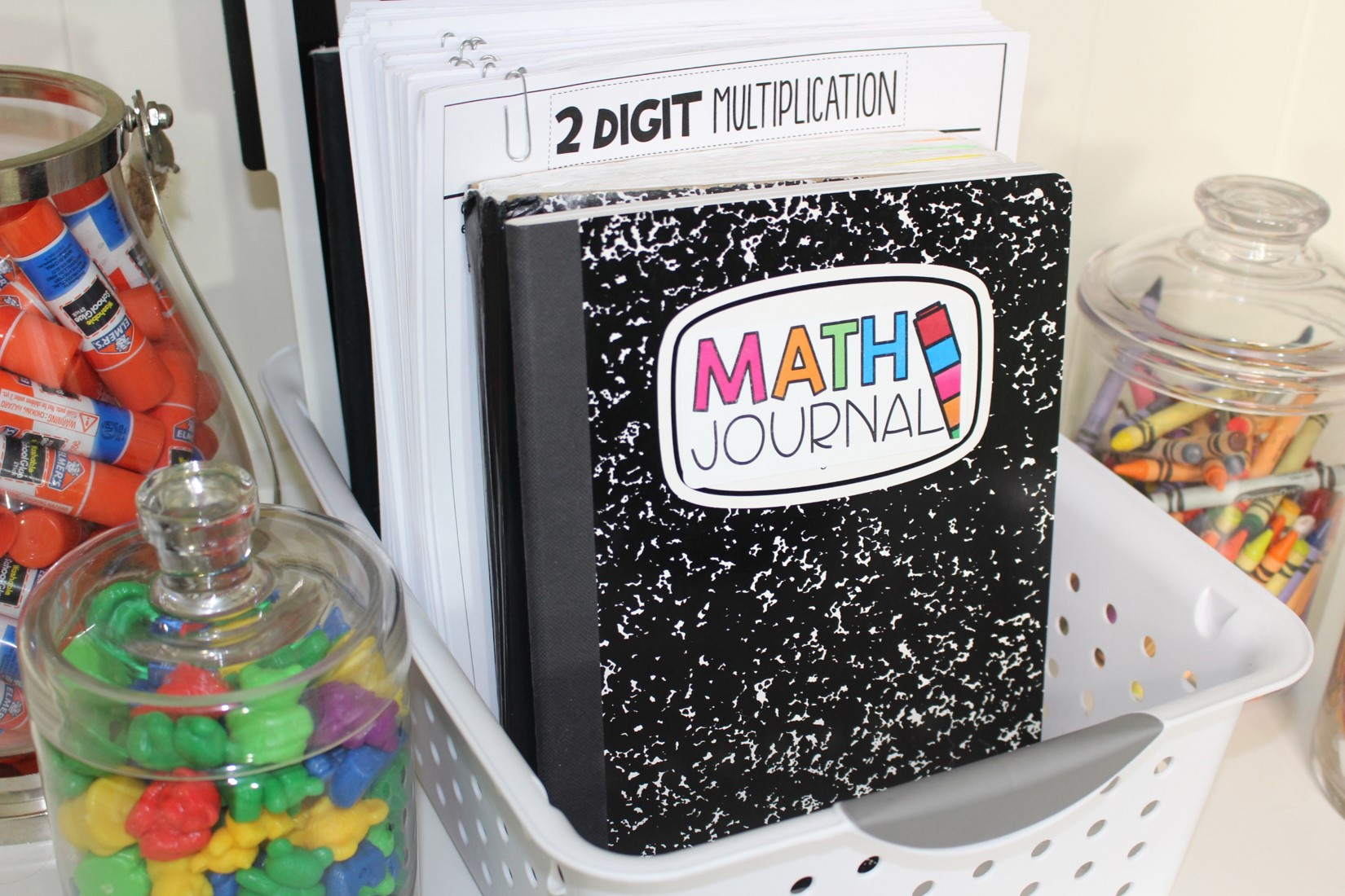 Getting started with math journals. Practice setting expectations. Learn to cut fold and glue. Set goals and make math journals go from dependent to independent! Free tabs, labels, and practice. K-4.